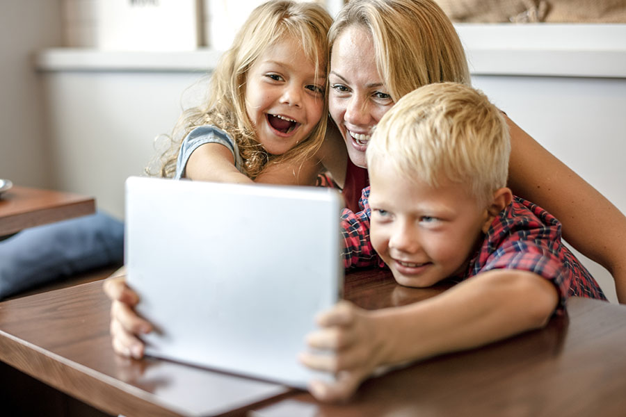 Client Center - Excited Mom And Children Using The Tablet At Home