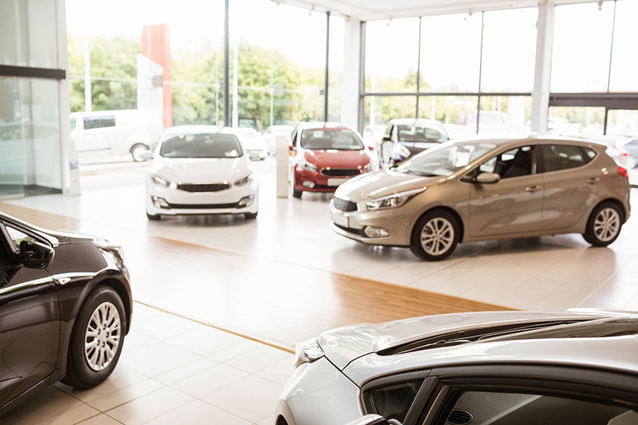 Specialized Business Insurance - Row Of Cars On Display Inside Car Dealership